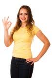 Ελκυστική νέα ασιατική καυκάσια επιτυχία χειρονομίας γυναικών στοκ εικόνα