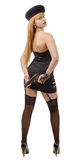 Ελκυστική νέα προκλητική γυναίκα με ένα πυροβόλο όπλο, πίσω άποψη Στοκ Εικόνα