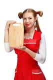 Ελκυστική νοικοκυρά στην κόκκινη ποδιά με τα αστεία ponytails και woode Στοκ φωτογραφία με δικαίωμα ελεύθερης χρήσης