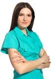 Ελκυστική νοσοκόμα σε ομοιόμορφο με το βραχίονα που διπλώνεται στοκ εικόνα
