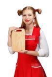 Ελκυστική χαμογελώντας νοικοκυρά στην κόκκινη ποδιά με τα αστεία ponytails α Στοκ φωτογραφίες με δικαίωμα ελεύθερης χρήσης
