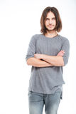 Ελκυστικός σοβαρός νεαρός άνδρας με μακρυμάλλη Στοκ φωτογραφία με δικαίωμα ελεύθερης χρήσης