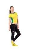 Ελκυστικό αθλητικό κορίτσι με τη βραζιλιάνα σημαία στην κίτρινη μπλούζα της Στοκ φωτογραφία με δικαίωμα ελεύθερης χρήσης
