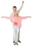 Ελκυστικό ζεύγος που χαμογελά και ενθαρρυντικό Στοκ Φωτογραφία
