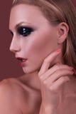 Ελκυστικό κορίτσι με τη σύνθεση και ένα ομαλό δέρμα Στοκ εικόνα με δικαίωμα ελεύθερης χρήσης