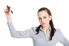 Ελκυστικό brunette που γράφει με τη μάνδρα στοκ εικόνες