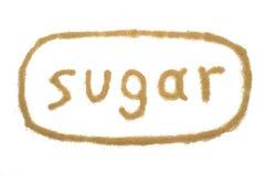 Ζάχαρη λέξης που γράφεται με την καφετιά ζάχαρη Στοκ φωτογραφία με δικαίωμα ελεύθερης χρήσης