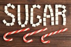 Ζάχαρη από τη ζάχαρη κύβοι επιγραφής Στοκ φωτογραφία με δικαίωμα ελεύθερης χρήσης