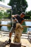 Ζήστε ξύλινα γλυπτά με την τέχνη Settala - Mi Prem ` - Ιταλία Στοκ Εικόνες