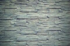 Ζαρωμένη σύσταση ενός τοίχου πετρών στο εκλεκτής ποιότητας ύφος στοκ εικόνες με δικαίωμα ελεύθερης χρήσης
