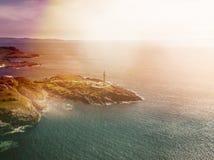 Ζαλίζοντας τον εναέριο πυροβολισμό του σημείου Ardnamurchan, μεγάλο Britains το περισσότερο δυτικό σημείο, με το φάρο και το όμορ Στοκ Εικόνες