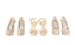 Ζευγάρια των παπουτσιών γυναικών στο λευκό Στοκ Εικόνες