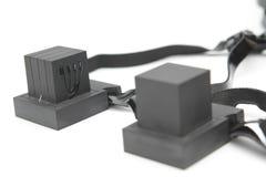 Ζευγάρι του tefillin, σύμβολο Α των εβραϊκών ανθρώπων, ένα ζευγάρι του tefillin με τα μαύρα λουριά, που απομονώνεται σε ένα άσπρο Στοκ εικόνα με δικαίωμα ελεύθερης χρήσης