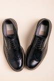 Ζευγάρι των παπουτσιών ξοντρών παπούτσεων ατόμων Στοκ εικόνες με δικαίωμα ελεύθερης χρήσης