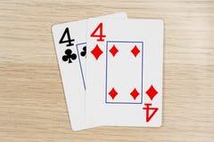 Ζευγάρι των fours 4 - κάρτες πόκερ παιχνιδιού χαρτοπαικτικών λεσχών στοκ φωτογραφίες