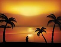 Ζεύγος και ηλιοβασίλεμα Στοκ Φωτογραφία