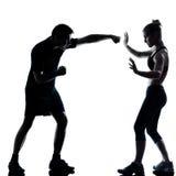 ζεύγος που ασκεί τον άνδρα ένα ικανότητας γυναίκα workout Στοκ φωτογραφία με δικαίωμα ελεύθερης χρήσης