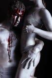 Ζεύγος τέχνης σωμάτων ασημιών και αίματος στοκ εικόνες