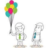 Ζηλόφθονος επιχειρηματίας που εξετάζει τα μπαλόνια Στοκ φωτογραφίες με δικαίωμα ελεύθερης χρήσης