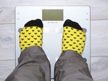 Ζυγοί, βάρος, πόδια, κάλτσες, υγεία Στοκ εικόνα με δικαίωμα ελεύθερης χρήσης