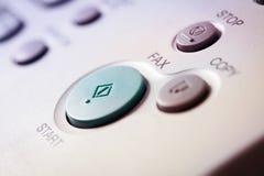 Ζωή γραφείων, fax, μηχανή αντιγράφων, στενός επάνω κουμπιών έναρξης Στοκ Φωτογραφίες