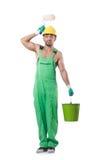 Ζωγράφος στις πράσινες φόρμες Στοκ Εικόνες