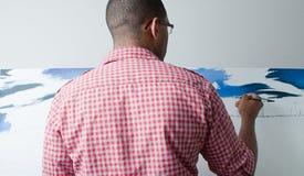 ζωγραφική αγοριών εφηβικ Στοκ Εικόνα