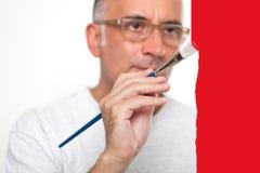 Ζωγραφική ατόμων σε έναν πίνακα γυαλιού Στοκ εικόνες με δικαίωμα ελεύθερης χρήσης