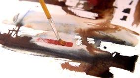 Ζωγραφική ενός έργου της τέχνης για χαρτί watercolor απόθεμα βίντεο