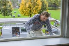 Ζωγραφική ενός σπιτιού στο εξωτερικό Στοκ Εικόνα