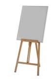 Ζωγραφική ξύλινου easel στάσεων με τον κενό πίνακα σημαδιών αφισών καμβά Στοκ εικόνα με δικαίωμα ελεύθερης χρήσης