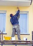 ζωγραφική σπιτιών προσόψε&ome Στοκ φωτογραφία με δικαίωμα ελεύθερης χρήσης