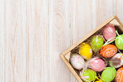 ζωηρόχρωμα αυγά Πάσχας κιβ Στοκ Εικόνες