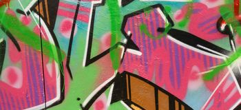 Ζωηρόχρωμα γκράφιτι που χρωματίζουν στον τοίχο, υπόβαθρο εμβλημάτων τέχνης οδών Στοκ φωτογραφίες με δικαίωμα ελεύθερης χρήσης