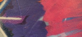 Ζωηρόχρωμα γκράφιτι που χρωματίζουν στον τοίχο, υπόβαθρο εμβλημάτων τέχνης οδών Στοκ Φωτογραφία