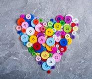 Ζωηρόχρωμα πλαστικά κουμπιά ιματισμού Στοκ Φωτογραφία