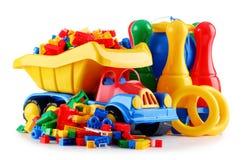 Ζωηρόχρωμα πλαστικά παιχνίδια παιδιών που απομονώνονται στο άσπρο υπόβαθρο Στοκ Εικόνα