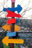 Ζωηρόχρωμα σημάδια με μορφή ενός βέλους Στοκ Εικόνες