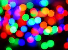 Ζωηρόχρωμα φω'τα Χριστουγέννων bokeh στοκ εικόνες