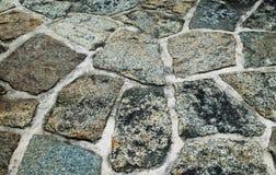Ζωηρόχρωμες διαφοροποιημένες πέτρες σύστασης υποβάθρου με το ρευστοκονίαμα Στοκ Φωτογραφίες