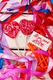 Ζωηρόχρωμες κορδέλλες και lollipops Στοκ Εικόνες