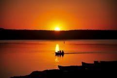 Ζωηρόχρωμες σκιαγραφίες ψαράδων Στοκ Φωτογραφίες