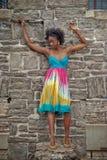 ζωηρόχρωμη γυναίκα φορεμά&ta Στοκ Φωτογραφία