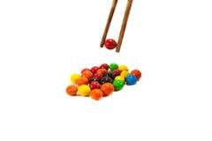 Ζωηρόχρωμη καραμέλα με chopsticks Στοκ φωτογραφία με δικαίωμα ελεύθερης χρήσης