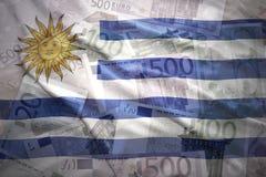 Ζωηρόχρωμη κυματίζοντας σημαία Ουρουγουανών σε ένα ευρο- υπόβαθρο Στοκ φωτογραφία με δικαίωμα ελεύθερης χρήσης