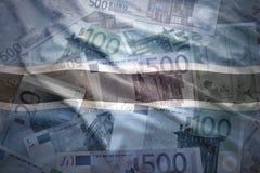 Ζωηρόχρωμη κυματίζοντας σημαία της Μποτσουάνα σε ένα ευρο- υπόβαθρο Στοκ Εικόνες