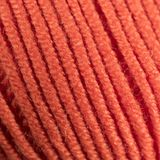 Ζωηρόχρωμη πορτοκαλιά μακρο κινηματογράφηση σε πρώτο πλάνο σφαιρών νημάτων μαλλιού Στοκ Εικόνες