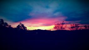 Ζωηρόχρωμη σκιαγραφία ουρανού στο ηλιοβασίλεμα Στοκ Εικόνα