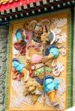 Ζωηρόχρωμη χαμηλή ανακούφιση του πολεμιστή Θεών σε Sik Sik Yuen Wong Tai Sin Στοκ εικόνα με δικαίωμα ελεύθερης χρήσης