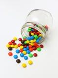 Ζωηρόχρωμοι ζαχαρωμένοι εξυπνάκιες σοκολάτας Στοκ Εικόνες